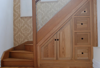 Home wall decoration modern homes under stairs cabinets for Stair cabinet design