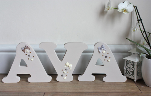 free standing beige bow button wooden letters