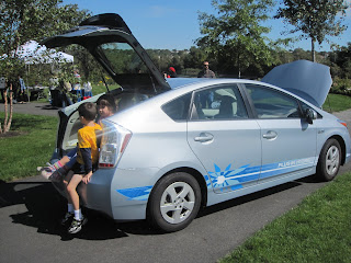 My kids sitting in the back of the Toyota Plug-in Prius