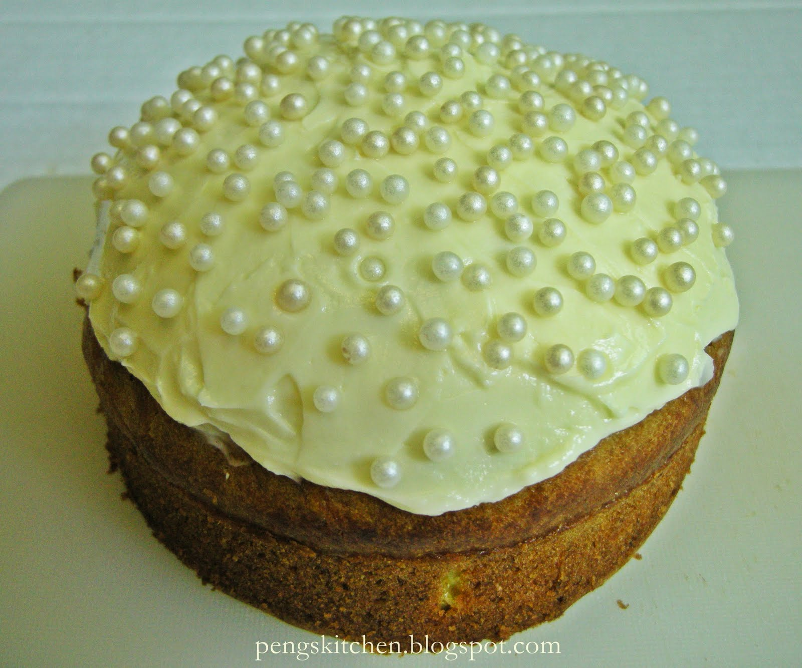 round cake with cream cheese frosting given this cake to a friend ...
