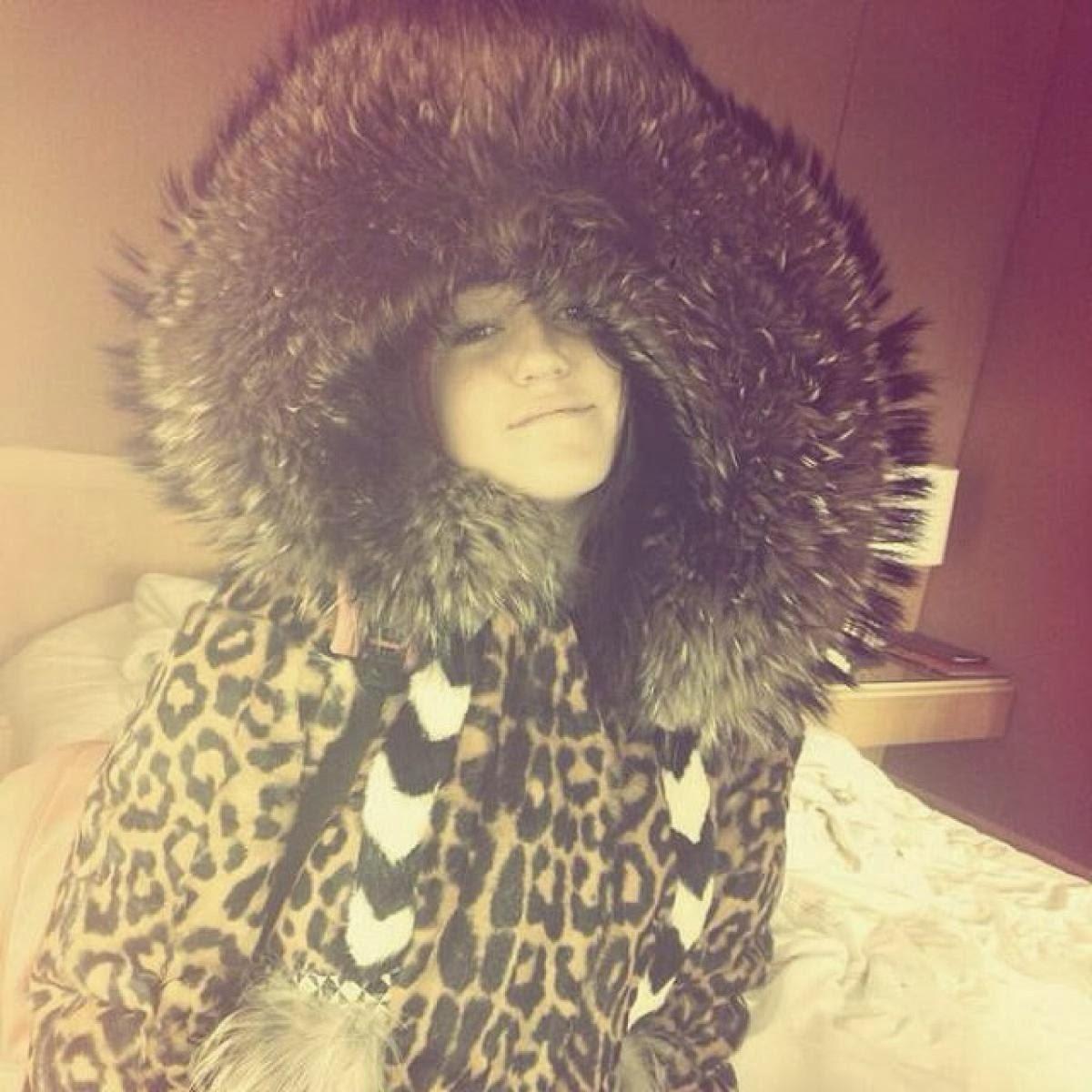 Miley Cyrus Covers up in a Massive Fur Hood Coat  e5d9fca5a0c6