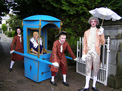 Sir Ian Wood carried on a sedan chair to an important event