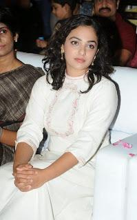 Actress Nithya Menen Pictures in White Long Dress at Malli Malli Idi Rani Roju Audio Launch  50