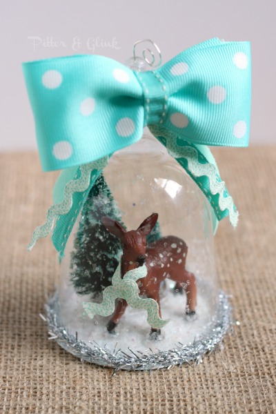 A beautiful vintage-inspired handmade snow globe ornament from pitterandglink.com.