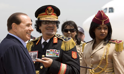 Silvio Berlusconi meets up with Muammar Gaddafi
