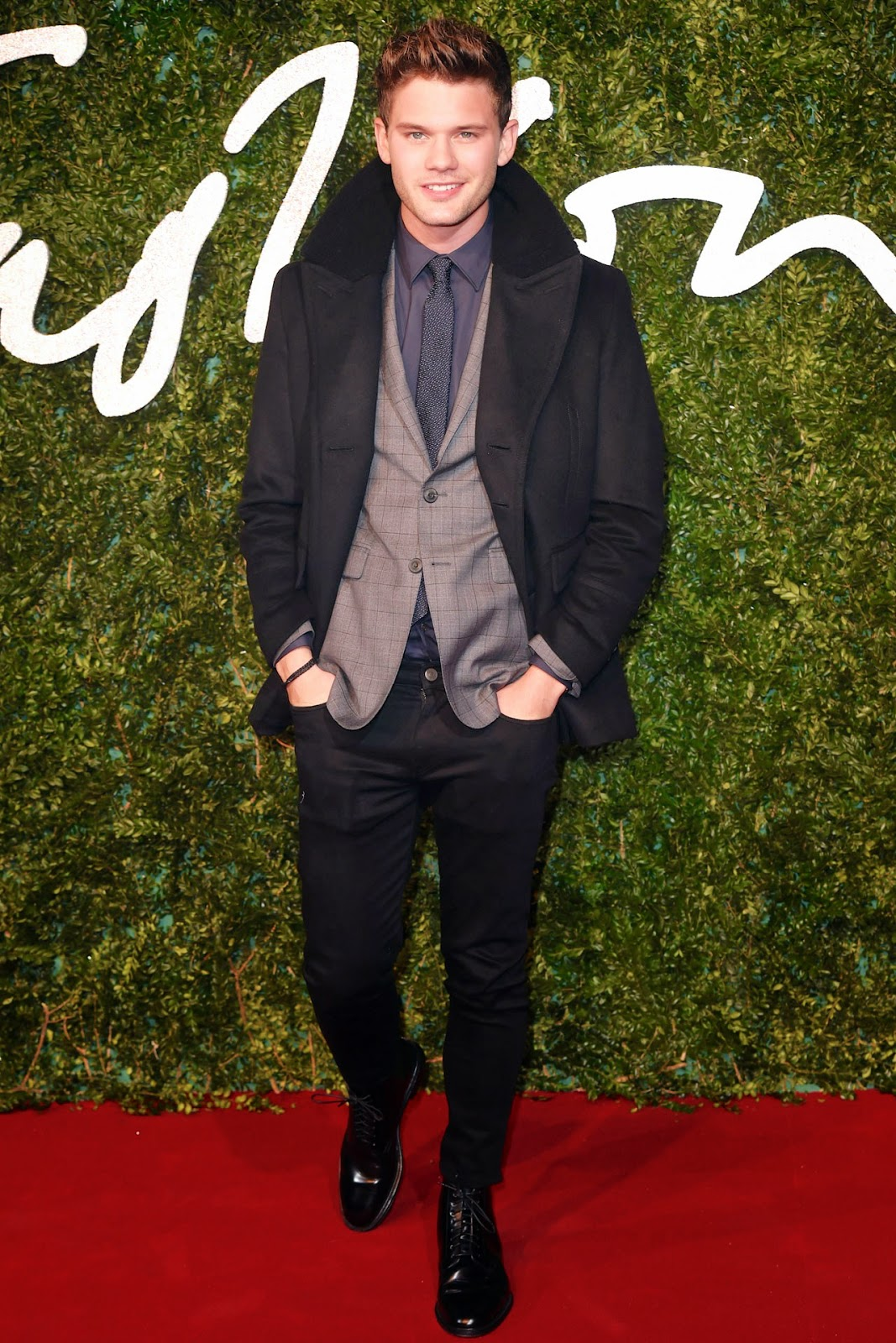 Jeremy Irvine wears Burberry shearling collar black peacoat to 2014 British fashion Awards