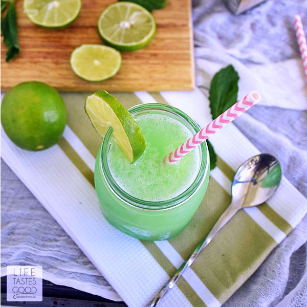 This Mojito Slush recipe | by Life Tastes Good is a mix of frozen limeade, grapefruit soda, fresh mint, and rum. The combination of sweet refreshing citrus and mint flavors with a little kick of rum is a popular summer cocktail. Perfect for a pool party!