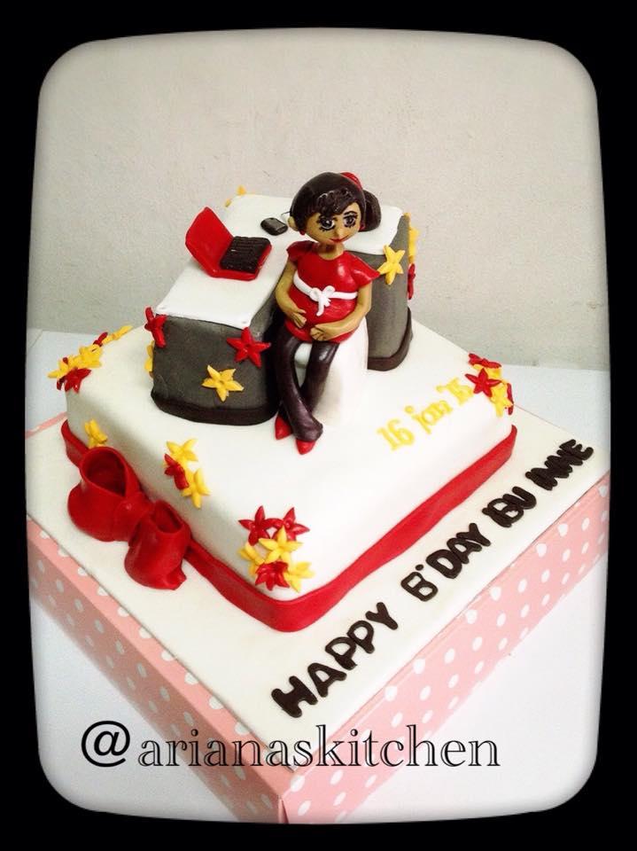 Arianas Kitchen office girl cake