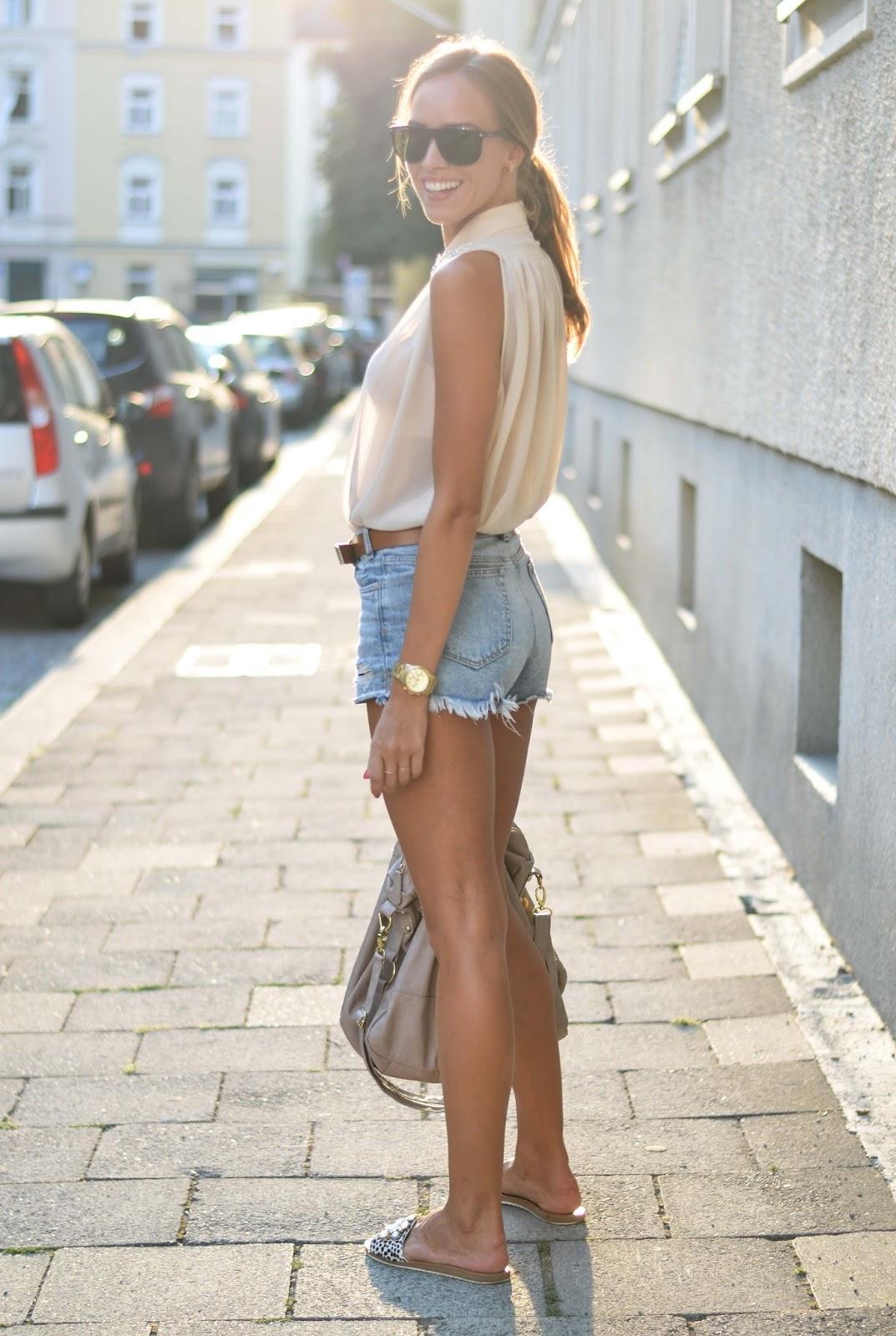 kristjaana mere denim shorts sleeveless top flat sandals summer outfit idea