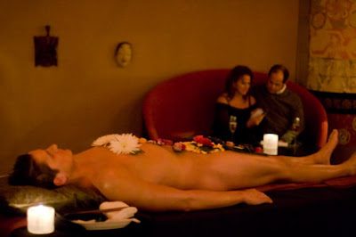 naked male sushi model, in buffet table with foods