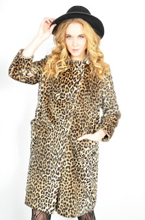 Vintage 1960's faux fur leopard print double breasted pea coat.