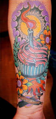 Tattoo of a cupcake with a candle and rolling pins with flowers by tattoo artist Jason Kunz for Triumph Tattoo