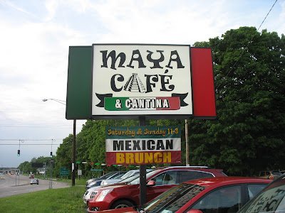 The sign outside of Maya cafe and Cantina