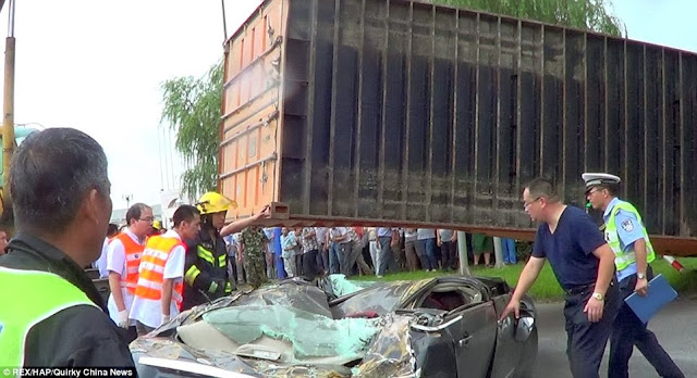 Flattened: The car had been absolutely destroyed by the weight of the container