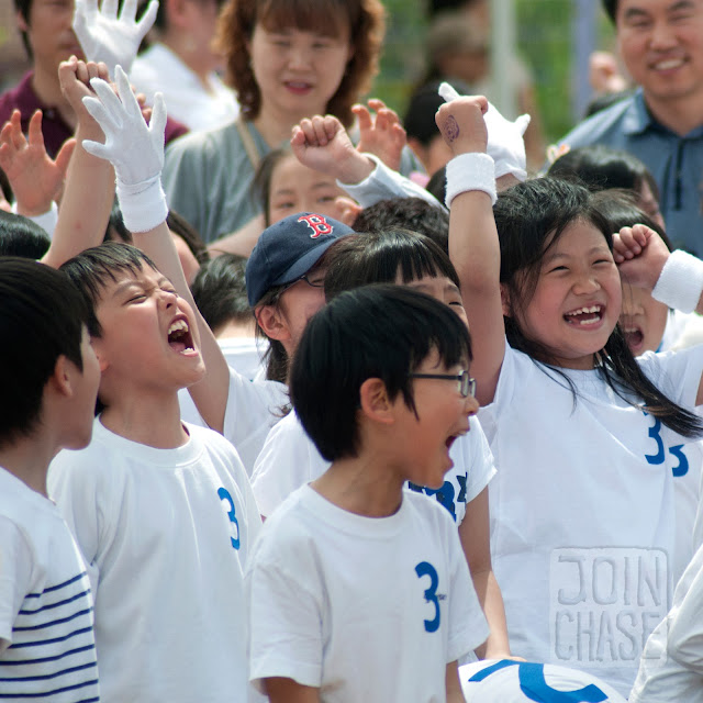 Korean students cheering during Sports Day at Bibong Elementary in Ochang, South Korea.