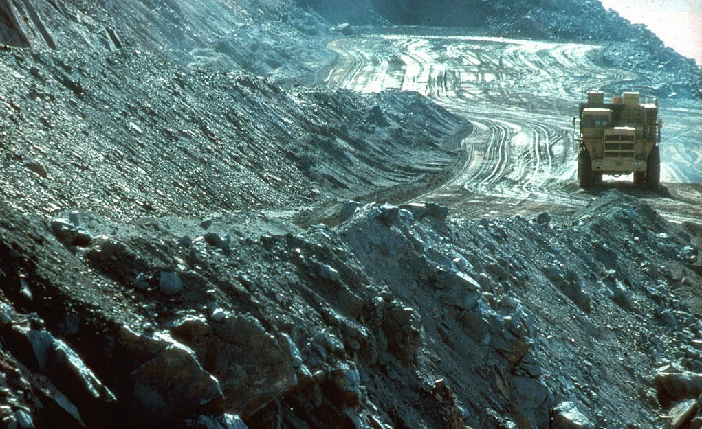 The scarred landscape of a vast open cut coal mine in Australia. (Credit: CSIRO via Wikimedia Commons) Click to Enlarge.