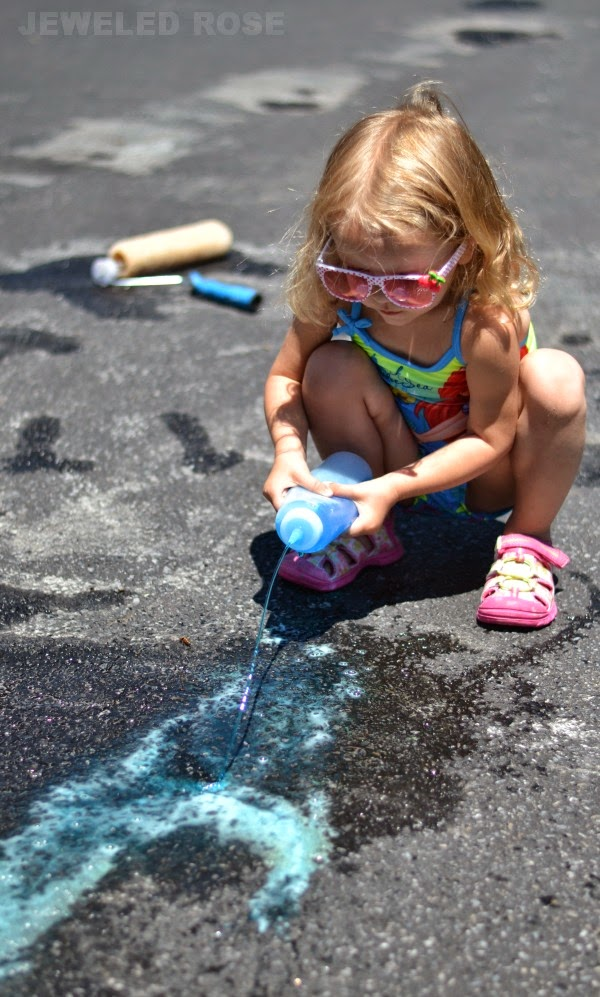 Painting with MAGIC water- a fun and frugal activity for Summer that costs less than $1 and will keep kids playing for hours!