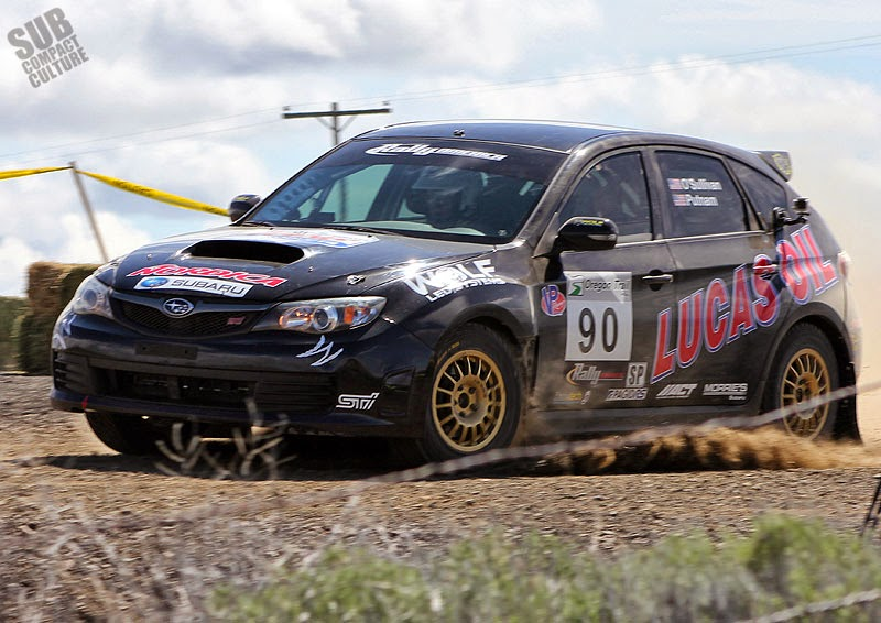 Black Subaru WRX STI rally car