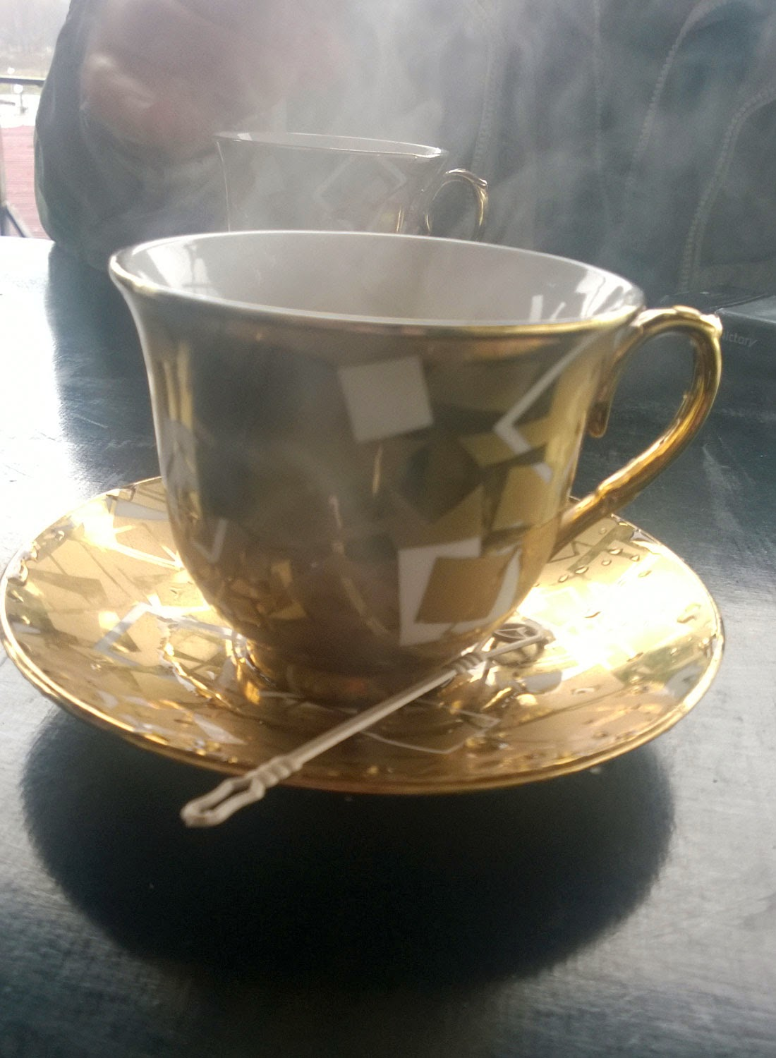 Coffee served in a golden cup