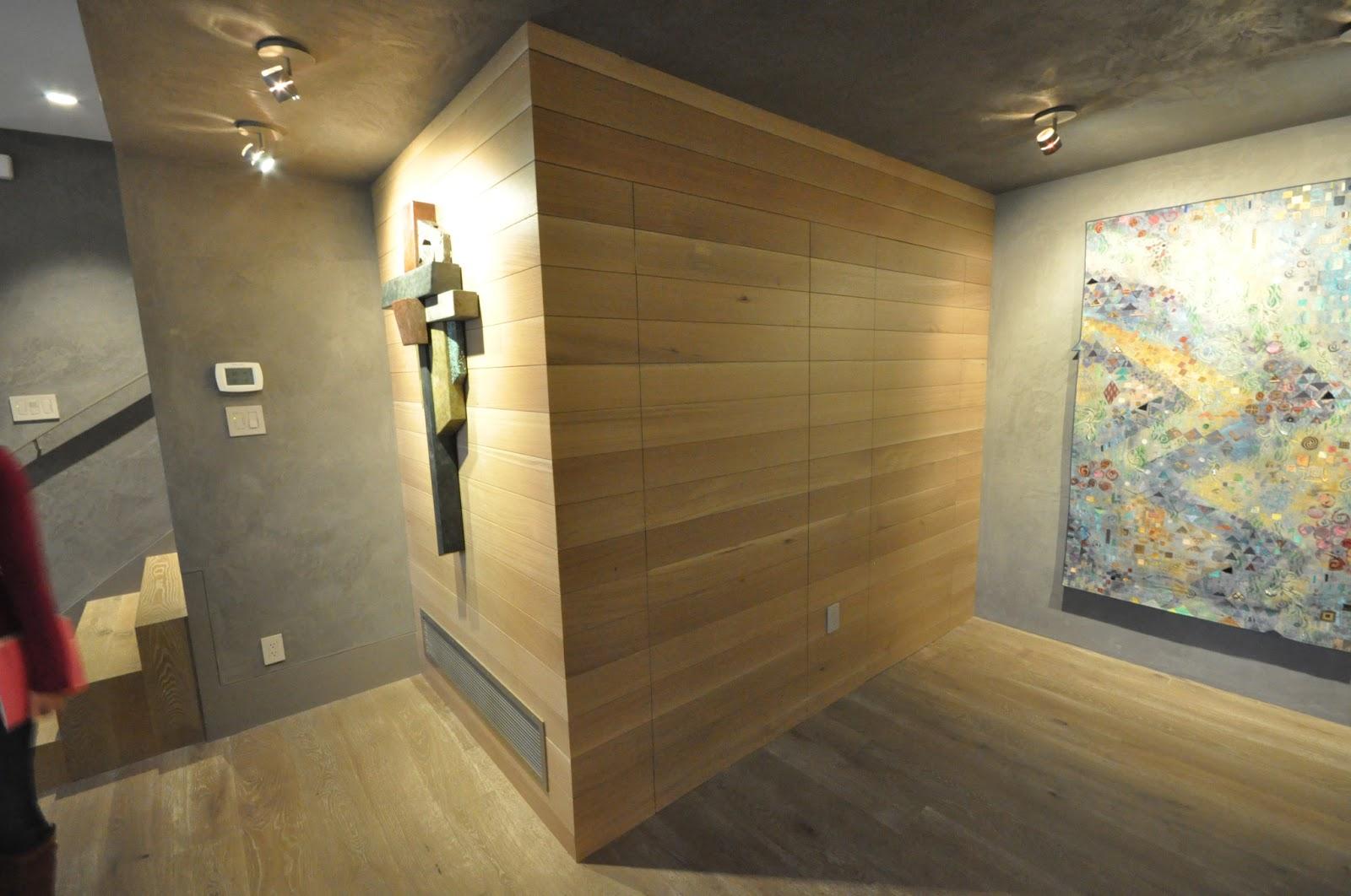 Oak paneled basement wall with two hidden doors, both doors closed
