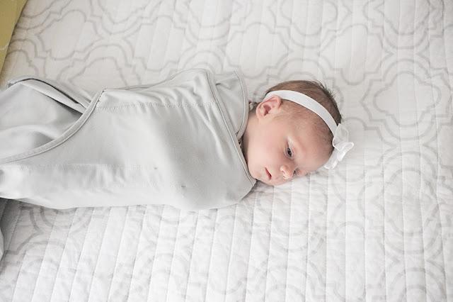 Baby London wearing Nuroo baby swaddler