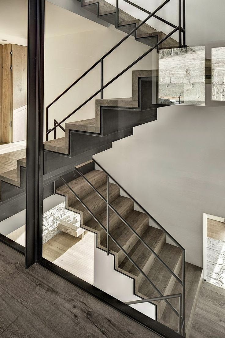 floating metal stairs with handrails
