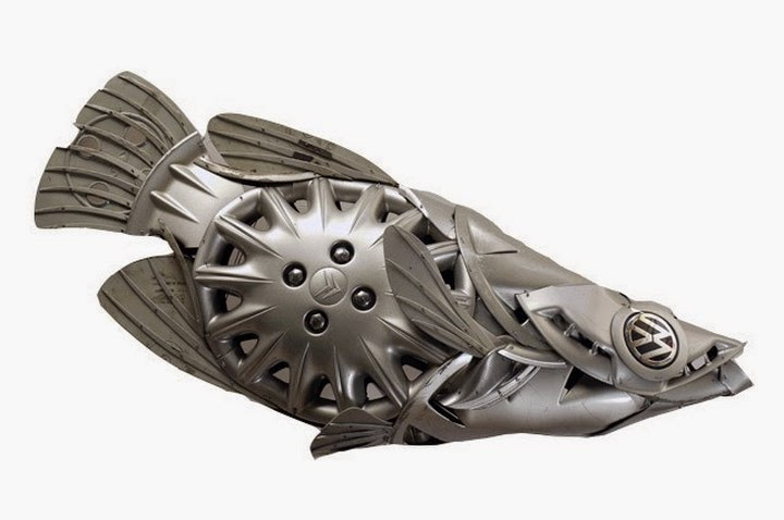 Simple  scrap metal and car wheel trims which he re shapes into a variety of life forms Out of these creatively re cycled sculptures fish sculptures are
