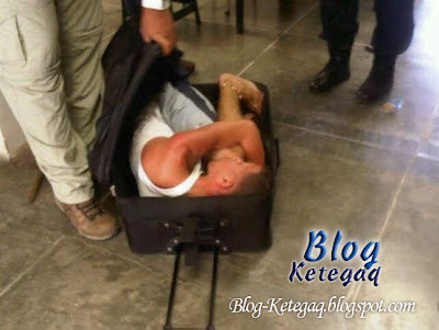 Banduan bersembunyi dalam bagasi