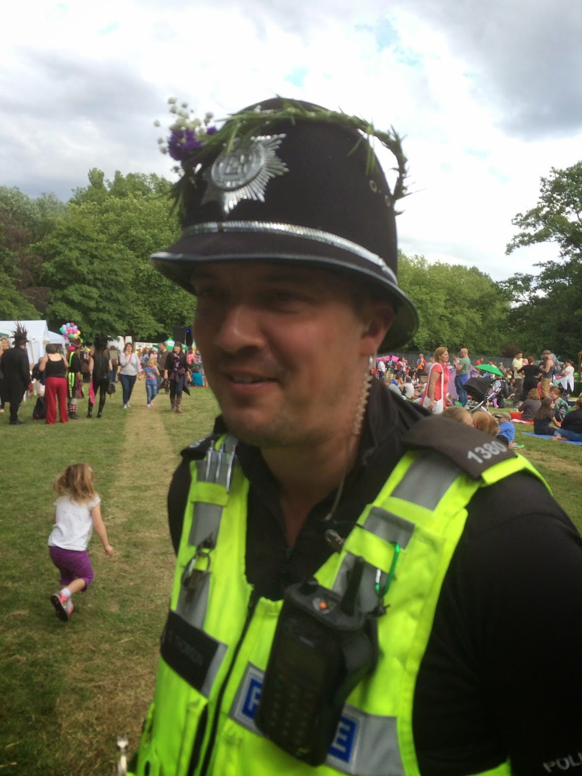 A local policeman gets into the festival spirit with a flower crown.
