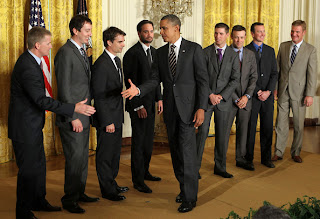 U.S. President Barack Obama (C) extends his hand for hand shakes with NASCAR drivers (L-R) Jeff Burton, Kyle Busch, Jeff Gordon, Jimmie Johnson, Denny Hamlin, Matt Kenseth, Kurt Busch, and Clint Bowyer during an East Room event September 7, 2011 at the White House in Washington, DC. Obama hosted the 2010 NASCAR Sprint Cup Series Champion Jimmie Johnson to honor his win. Johnson is the only driver in the NASCAR history to win in five consecutive years.