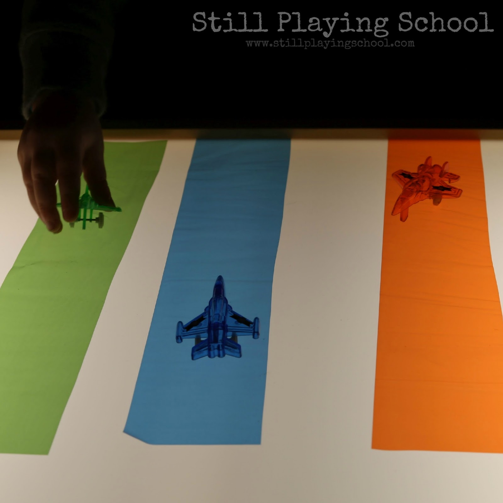 airplane color sorting on the light table still playing