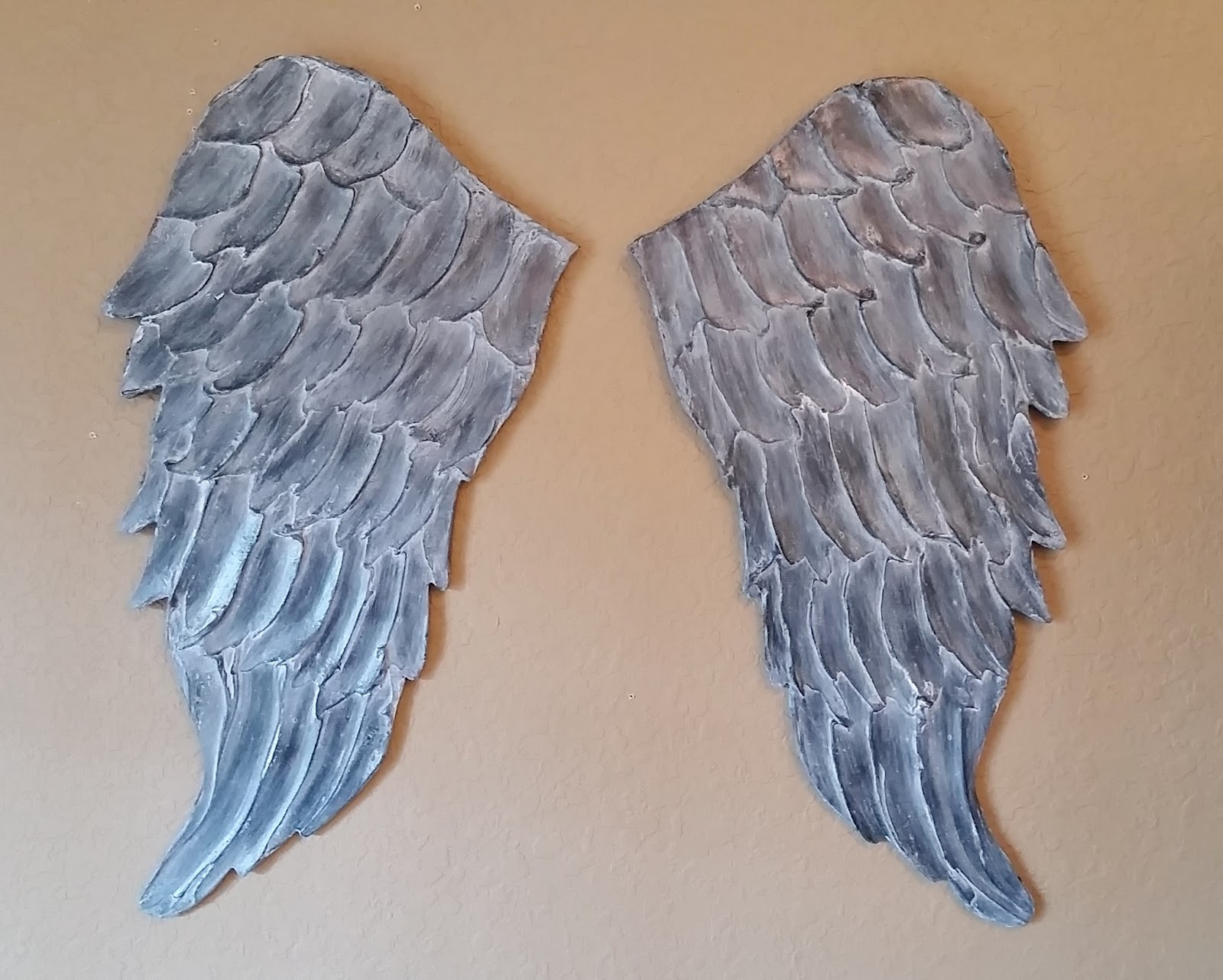 whitewashed gray angel wings