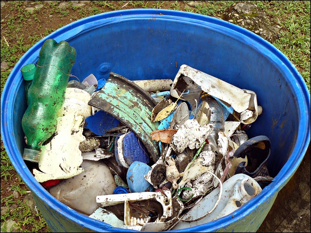Nearly full trash barrel of plastic Tamara picked up on the beach