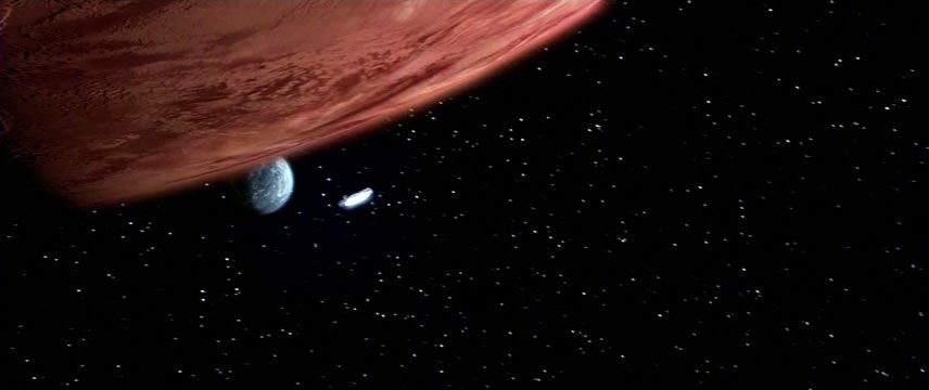 millenium falcon approaching yavin giant gas planet for the battle on its fourth moon