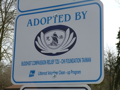 Sign at BRG gardens entrance recognizing Tzu Chi work in Port Credit.