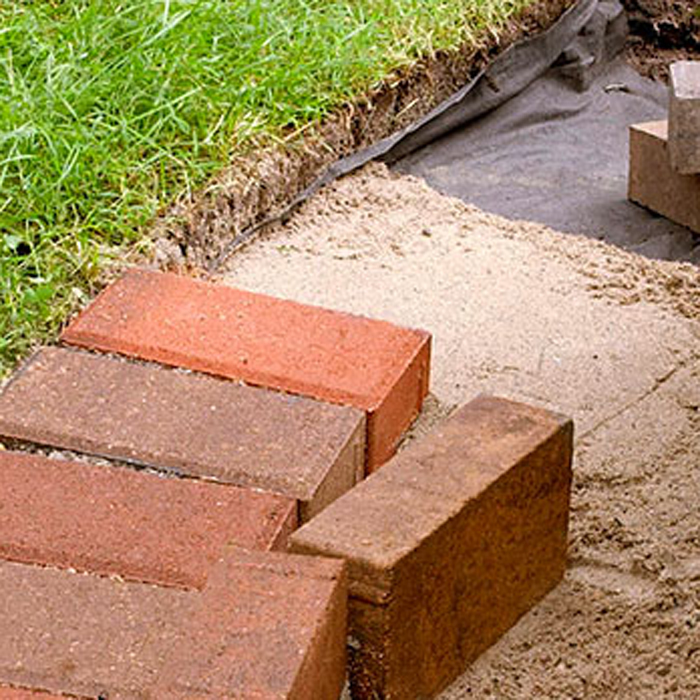 Brick driveway image brick border edging for Garden brick border designs