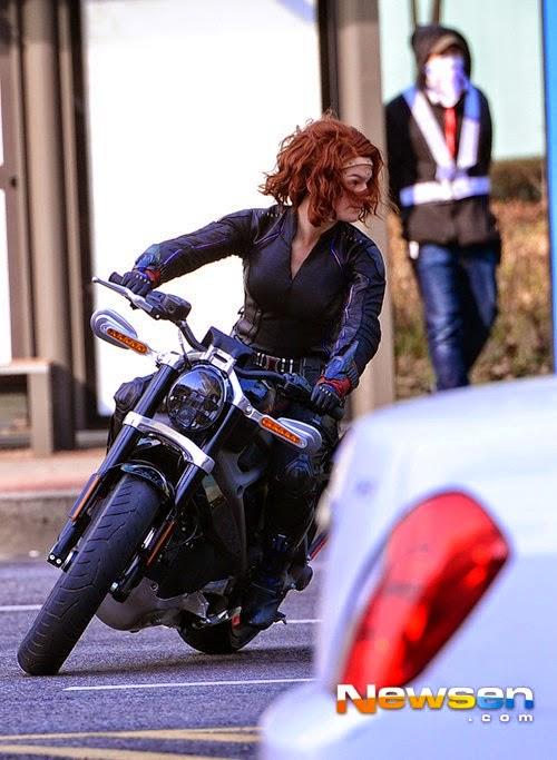 Scarlett Johansson as Black Widow riding an electric motorcycle