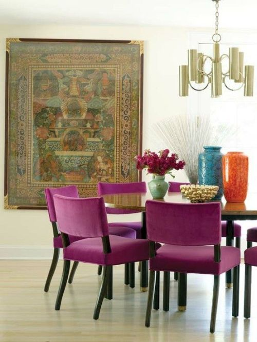 Pantone Radiant Orchid chairs and colorful vases in a dining room