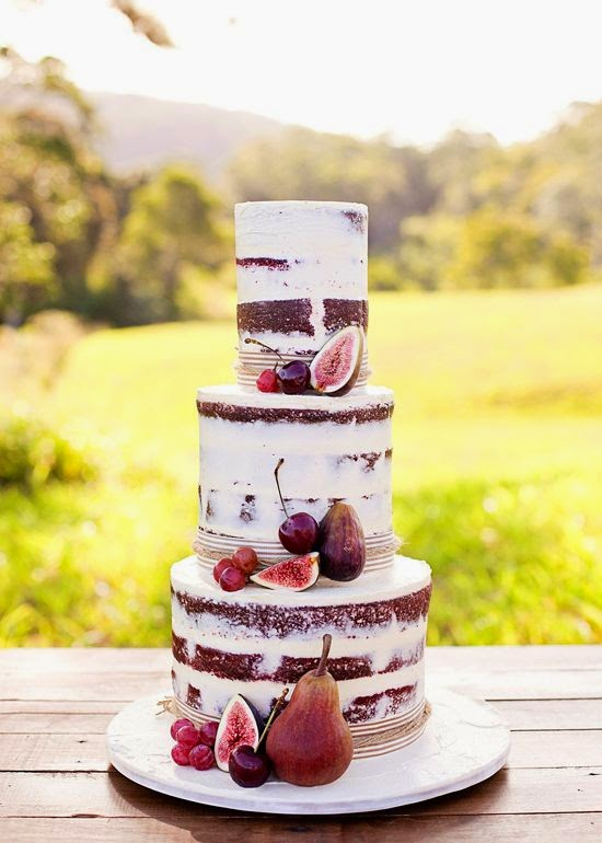 naked wedding cake with pomegranates