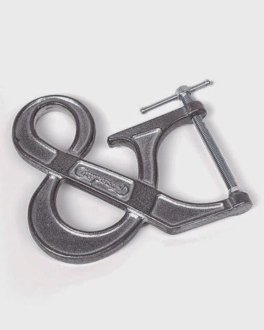 http://www.handeyesupply.com/products/the-adjustable-clampersand