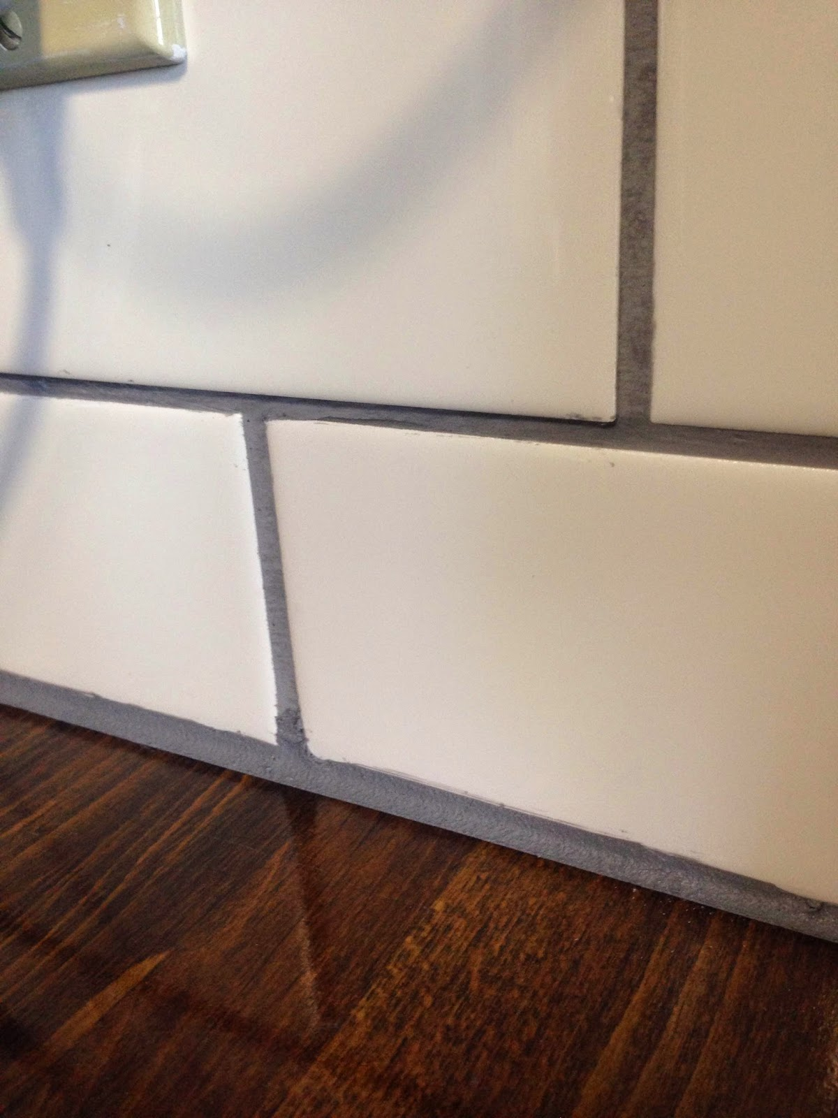 This Is Where I Learned My Lesson, And Put The Tape Further From The Wall  If You Get Big Smudges On The Tile, You Can Scrap Them Off With Your Finger  Nail