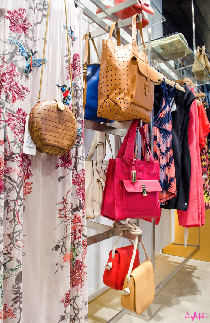 A number of neutral and colourful bright bags are on display along with printed dresses in the French Connection store at the Palladium mall, Mumbai