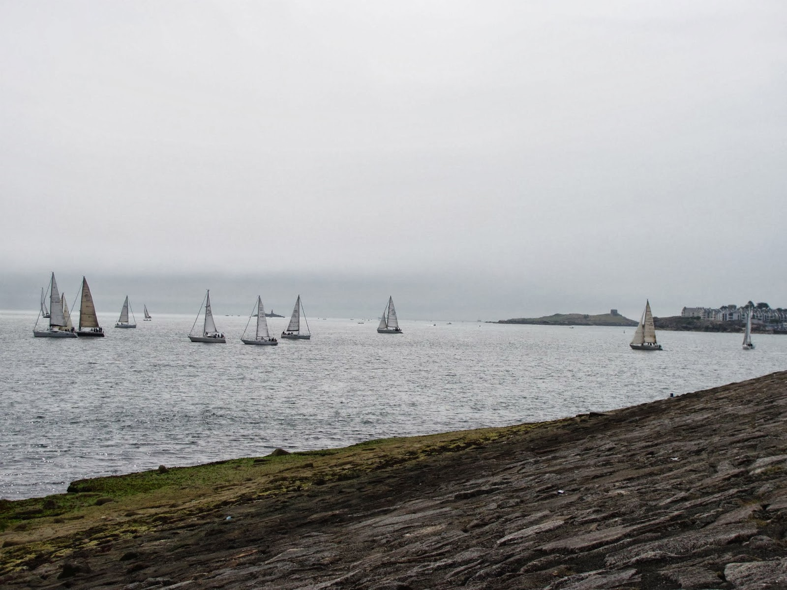 Sailboats are grouped together in Dublin Bay at Dun Laoghaire, Co. Dublin, Ireland