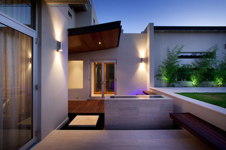 House facade and Modern backyard by Ritz Exterior Design