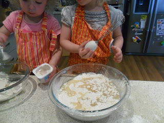 Adding wet ingredients to flour and sugar for cupcake recipe
