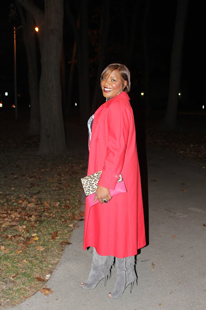 Enjoying-fall-weather-while-wearing-a-beautifully-long-red-vintage-trench-coat-that-compliments-the=-colors-of-the-leaves