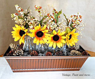 Vintage, Paint and more... sunflower centerpiece done in a bronz container