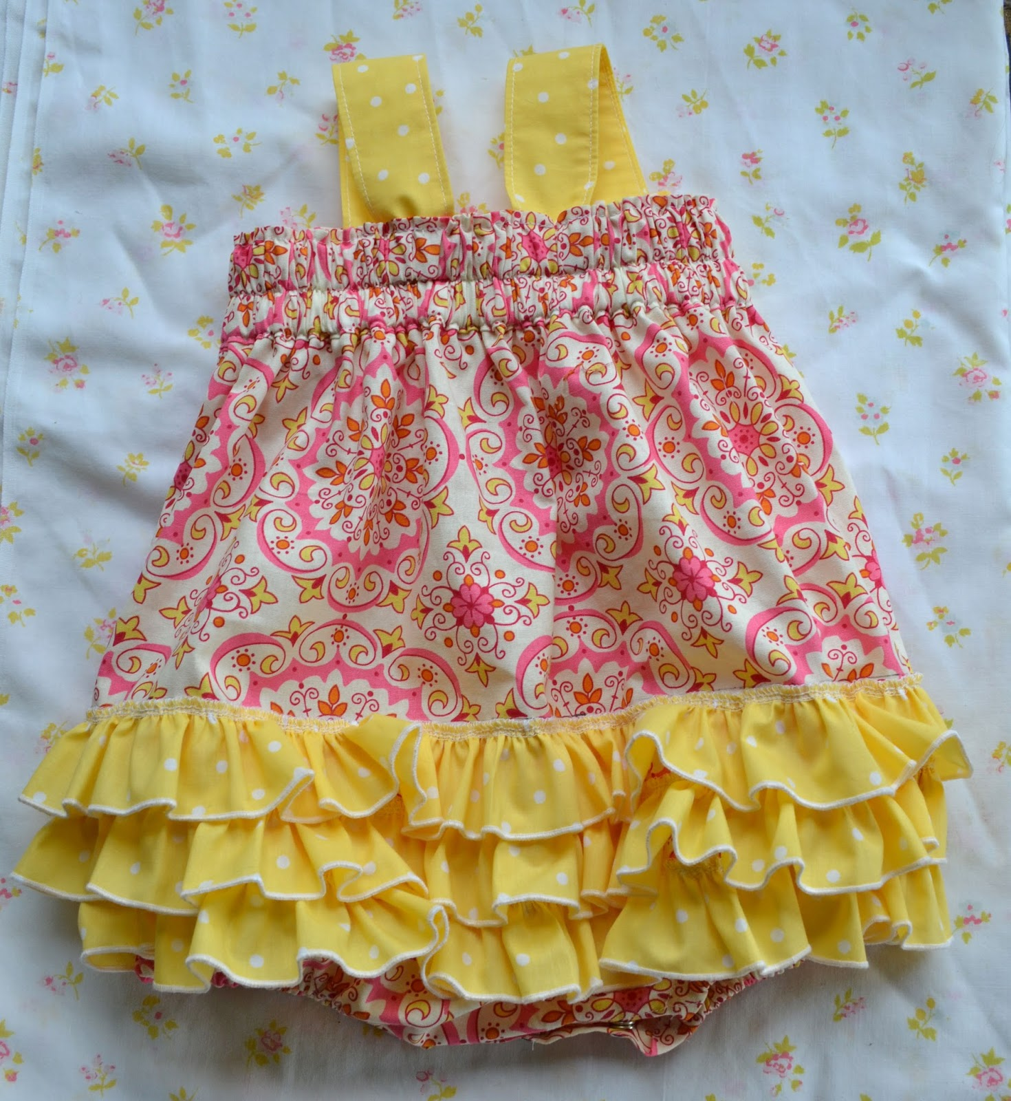 pink and yellow baby romper