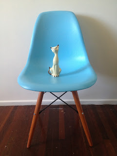 replica Eames moulded plastic dining chair in blue