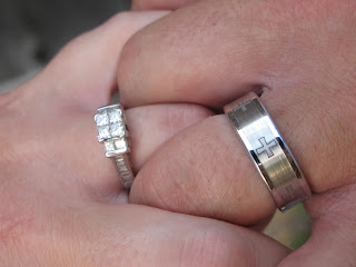wedding rings on couples hands